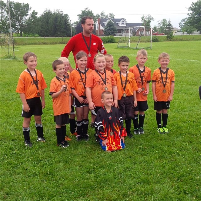 Coach_Tony_Douglas_and_the_2013_U8_Champs.jpg